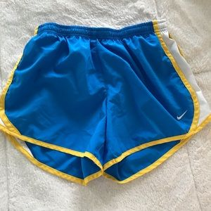 Blue yellow and white nike shorts